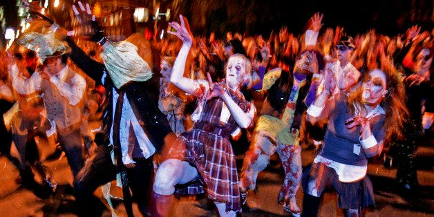 "Participants of Greenwich Village's Halloween parade re-enact the zombie strut from Michael Jackson's ""Thriller"" video, Frida"