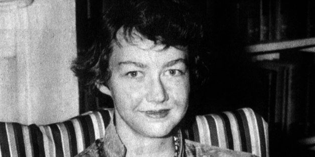 American writer Flannery O'Connor (1925-1964) with her book 'Wise Blood' 1952 (Photo by APIC/Getty Images)