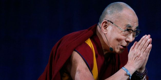 The Dalai Lama bids the audience goodbye at the Massachusetts Institute of Technology in Cambridge, Mass., Friday, Oct. 31, 2