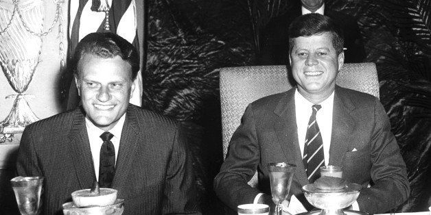US President John F. Kennedy (1917 - 1963) (right) sits with Christian evangelist Billy Graham at the National Prayer Breakfa