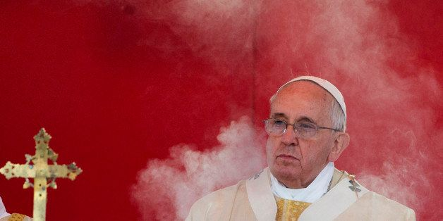 Incense smoke rises in front of  Pope Francis as he celebrates a mass at Rome's Verano cemetery, on the occasion of All Saint