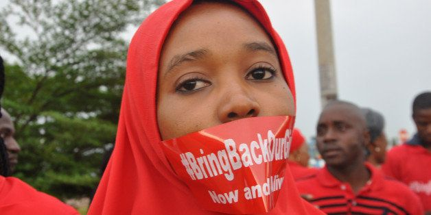 A woman attends a demonstration in Abuja, Nigeria, Thursday Sept. 11, 2014, calling on the government to rescue the kidnapped
