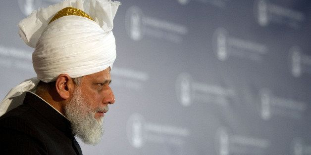 Devotees follow a speech by Mirza Masroor Ahmad, the head of the Ahmadiyya Muslim Jamaat Community at a Mosque in Hamburg, no