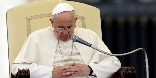 Pope Francis pauses during the weekly general audience in St. Peter's Square, at the Vatican, Wednesday, Nov. 12, 2014. (AP Photo/Gregorio Borgia)