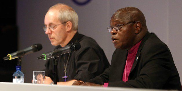 Archbishop of York John Sentamu (R) and Archbishop of Canterbury Justin Welby (L) speak at a press conference after members o