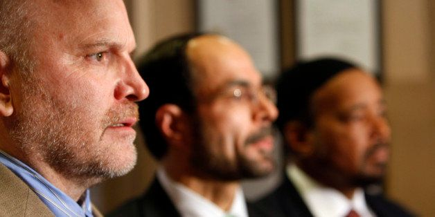 Ibrahim Hooper, left, spokesman for the Council on American-Islamic Relations, speaks at a news conference regarding the arre