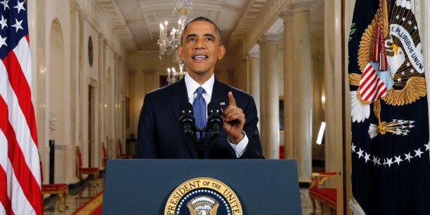 U.S. President Barack Obama speaks during a news conference in Washington, D.C., U.S., on Thursday, Nov. 20, 2014. Obama said