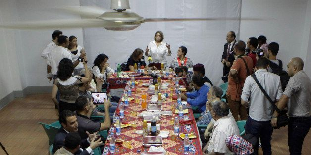 Egyptian Jewish community leader, Magda Haroun, top center, welcomes visitors during its Iftar party, evening meal when Musli