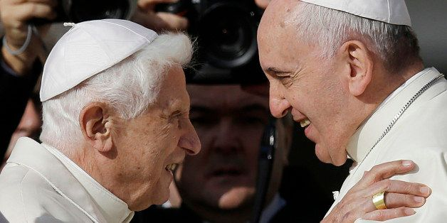 Pope Francis, right, hugs Pope Emeritus Benedict XVI prior to the start of a meeting with elderly faithful in St. Peter's Squ