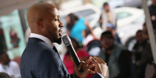 FERGUSON, MO - NOVEMBER 30:  Carlton Lee delivers a sermon at The Flood Christian Church on November 30, 2014 in Ferguson, Mi