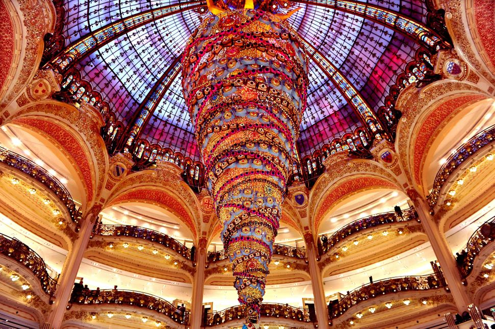 A 82-foot-high Christmas tree is seen inside a shopping mall in Paris, France, on Nov. 27, 2014.