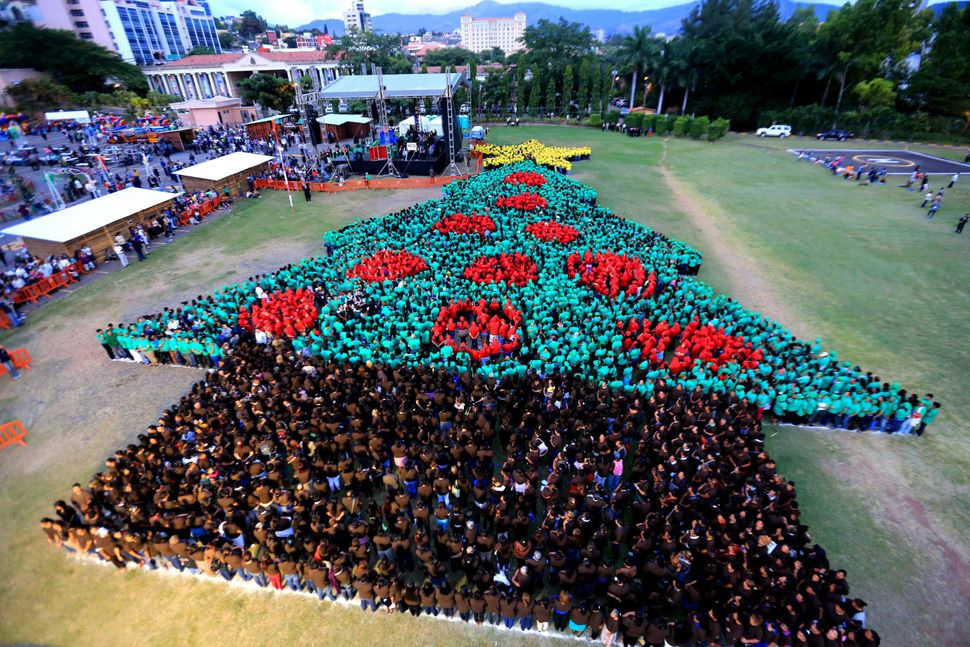 A photo provided by Honduras Presidency shows people participating in an event to break a Guinness Record for world's biggest