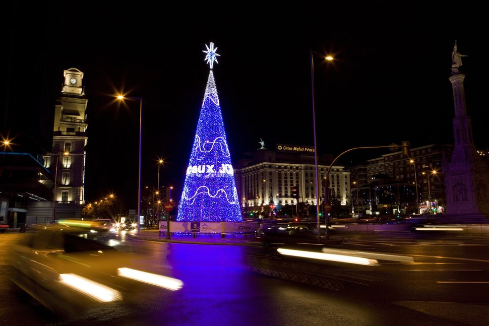 Christmas tree illuminates Colon square in the centre of Madrid on November 30, 2014.