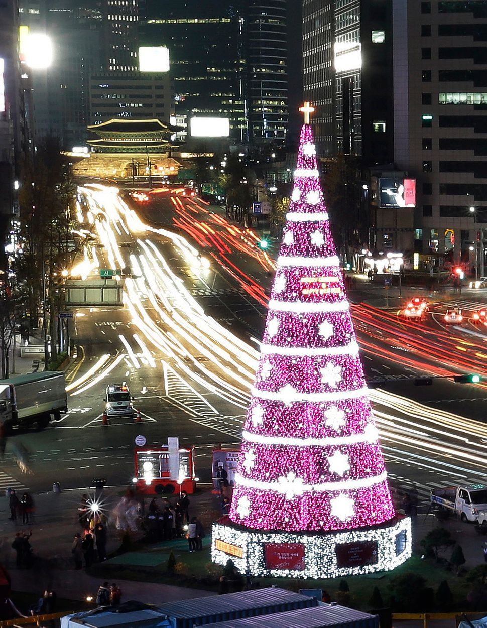 A 69-foot-high Christmas tree is lit to celebrate the upcoming Christmas season at Seoul City Hall Plaza, South Korea, Saturd
