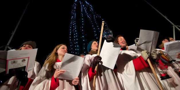 A choir sings christmas carols during the official ceremony to turn on the Christmas tree lights in Trafalgar Square, central