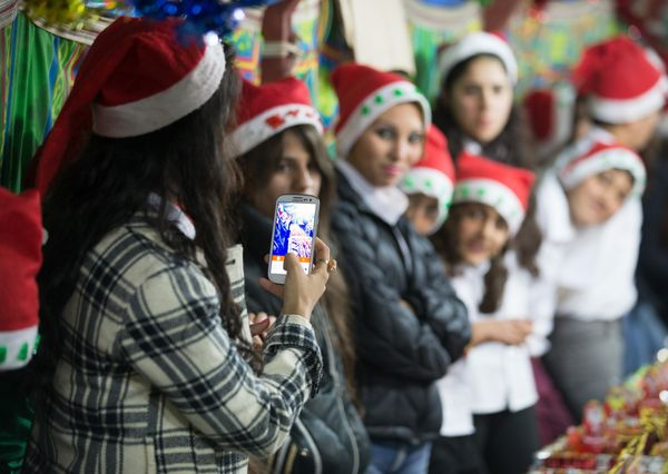 ERBIL, IRAQ - DECEMBER 14:  Young Christians sit gather to sell Christmas merchandise made by displaced Iraqi Christian child