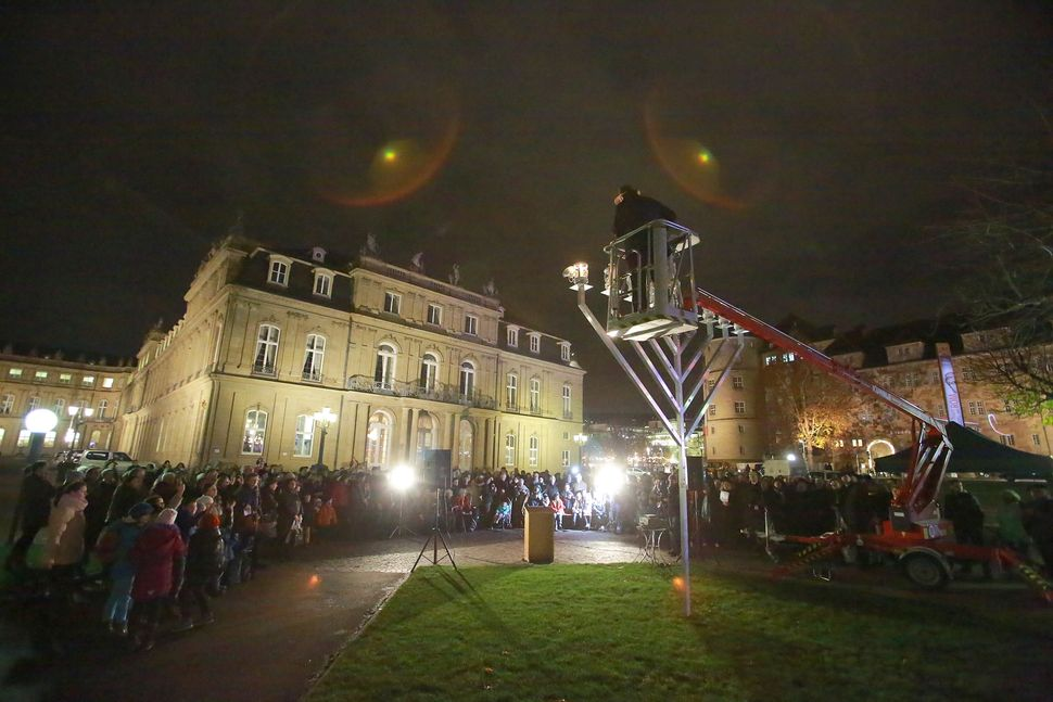 STUTTGART, GERMANY - DECEMBER 16:  Jews gather in front of the Neue Schloss for the lighting of the Menorah on the first nigh
