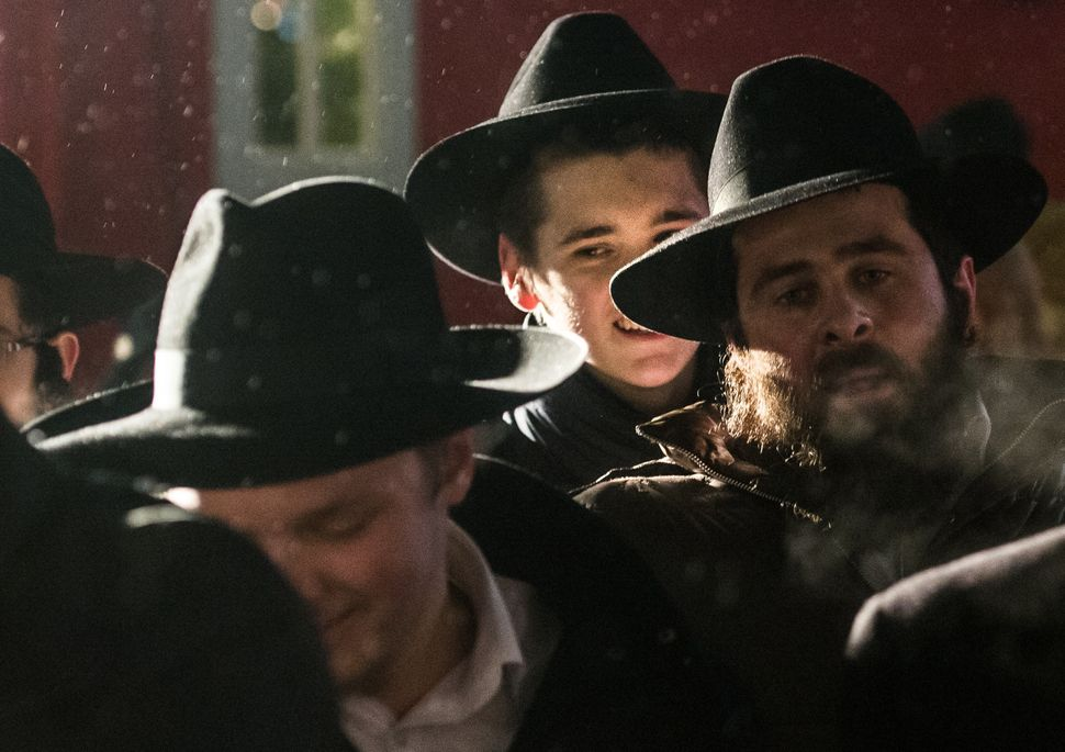 Jewish men gather to mark the start of Judaism's festival of light, Hanukkah in central Moscow on December 16, 2014.