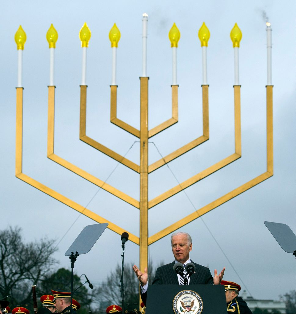 Vice President Joe Biden speaks after the national menorah was lit during a ceremony marking the start of the celebration of