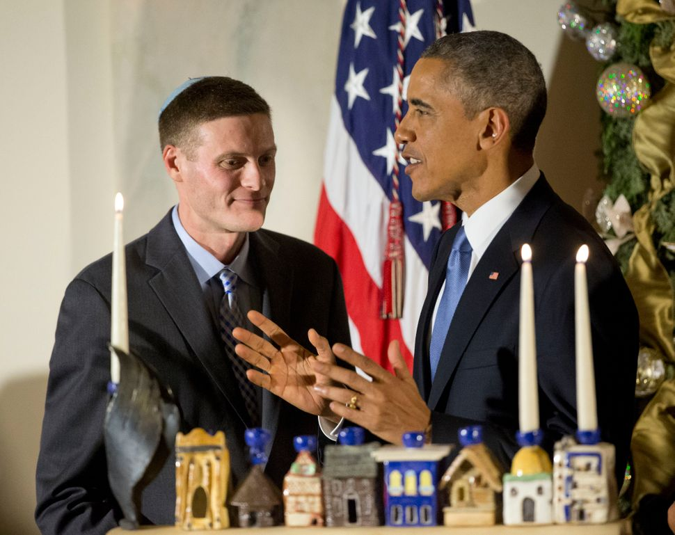 President Barack Obama, right, and Dr. Adam Levine attend a Hanukkah reception Wednesday, Dec. 17, 2014, in the Grand Foyer o