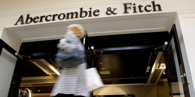 FILE - In this Thursday, Dec. 4, 2008, file photo, a shopper hurries past the Abercrombie & Fitch store at Beachwood Place Mall in Beachwood, Ohio. Drops in sales and weak profit forecasts are quite a change for the retailers that gained popularity in the last decade among teens that coveted their logo tees and trendy jeans that became a high school uniform of sorts. But these stores have been losing favor with their core demographic since the recession. (AP Photo/Amy Sancetta, File)