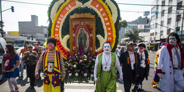 MEXICO CITY, MEXICO - DECEMBER 16:  Clowns march to the Basilica of Guadalupe on December 16, 2014 in Mexico City, Mexico. Th