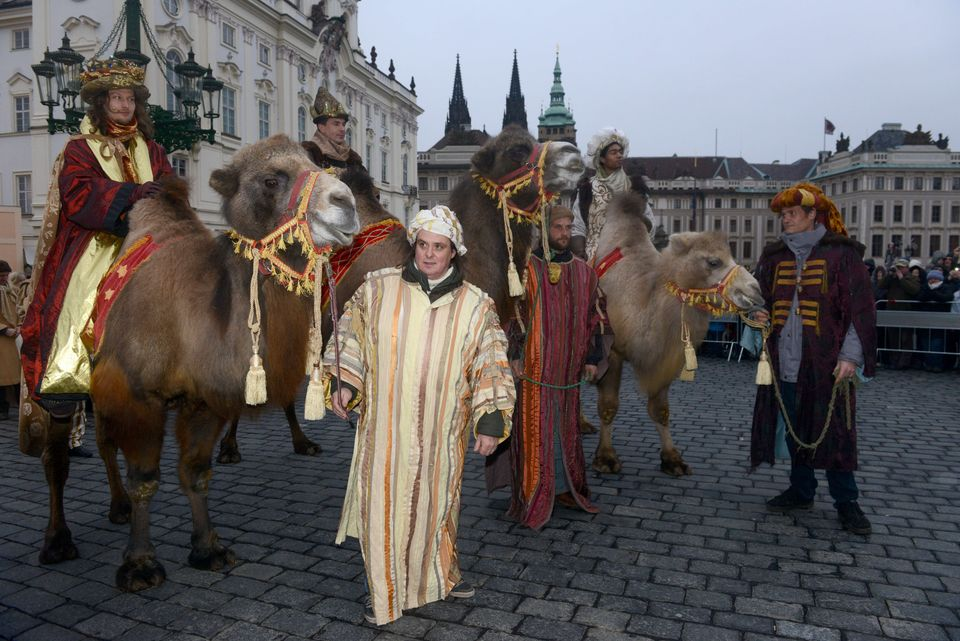Men dressed as the Three Kings ride camels as they take part in a procession featuring the kings' journey to the Christ child