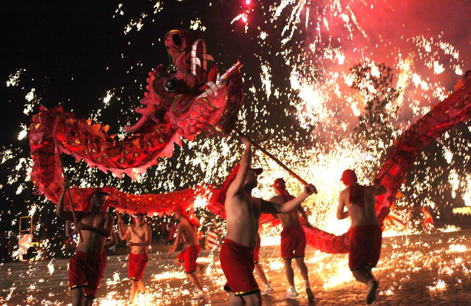This picture taken on February 14, 2014 shows Chinese villagers perform a dragon dance to celebrate the lantern festival in Y