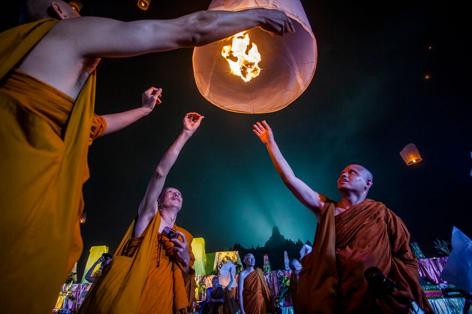 Buddhist monks release a lantern into the air at Borobudur temple during celebrations for Vesak Day on May 15, 2014 in Magela