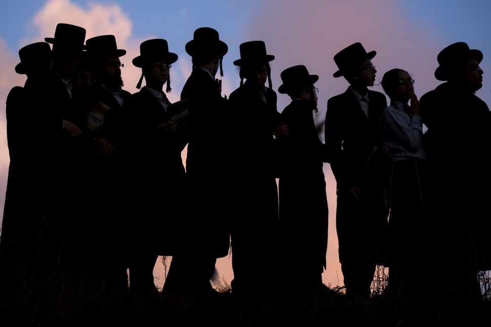 "Ultra-Orthodox Jews pray along the Ayarkon River in the city of Ramat Gan near Tel Aviv during the ritual of ""Tashlich"" on Oc"