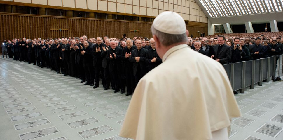 In this picture provided by the Vatican newspaper L'Osservatore Romano, Pope Francis arrives for a meeting with Roman priests