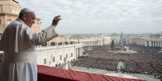 "In this picture provided by the Vatican newspaper L'Osservatore Romano, Pope Francis delivers his ""Urbi et Orbi"" (to the city"