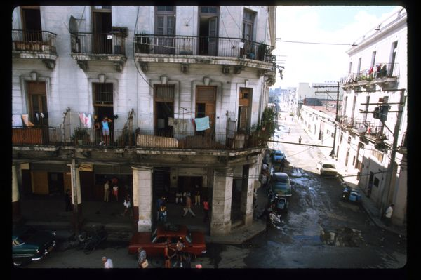 1999 - Cubans stand on the balcony of their apartment in Havana, Cuba.