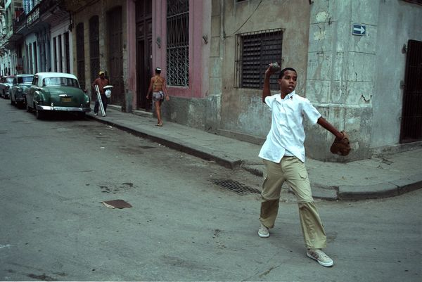2003 -  A young Cuban plays baseball in the streets of Havana. The normalization of relations with Cuba could eventually caus