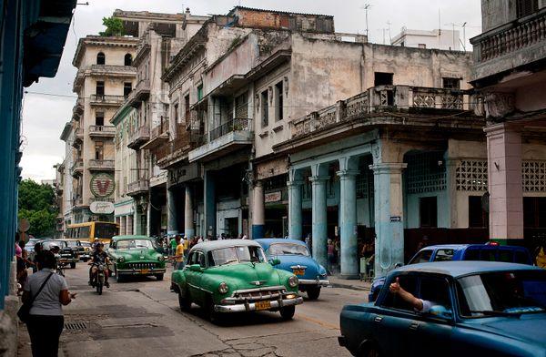 2012 - Cars drive down a street in Havana.
