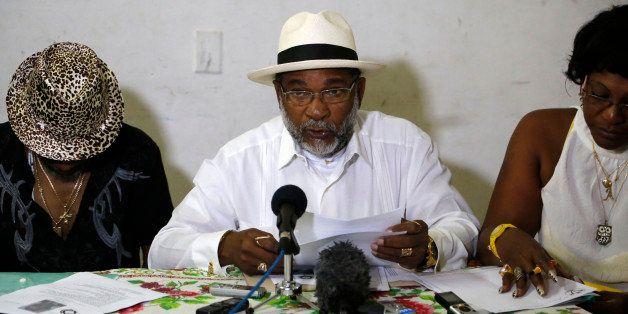 Afro-Cuban Santeria priest Lazaro Cuesta reads predictions for 2015 in Havana, Cuba, Saturday, Jan. 3, 2015. Cuesta, one of t
