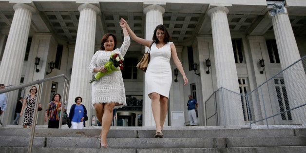 MIAMI, FL - JANUARY 05: Newlyweds Karla Arguello (L) and Catherina Pareto walk out of the Miami-Dade courthouse as the first