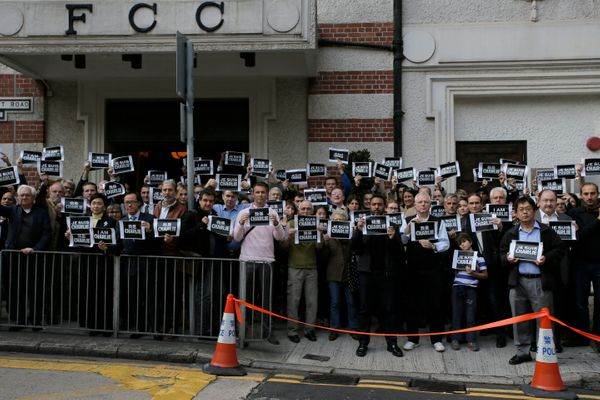 """Journalists and supporters of press freedom show off signs reading """"Je Suis Charlie (I Am Charlie)"""" during a gathering to pay"""