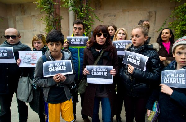 French journalists and their families show solidarity with the French satirical paper Charlie Hebdo at the French embassy in