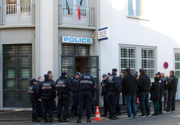 French municipal police prepare to observe a minute of silence in front of a police station in Biarritz, southwestern France,