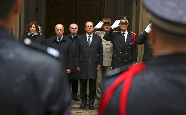 French President Francois Hollande, center, with at his side interior minister Bernard Cazeneuve, left, and Paris police pref