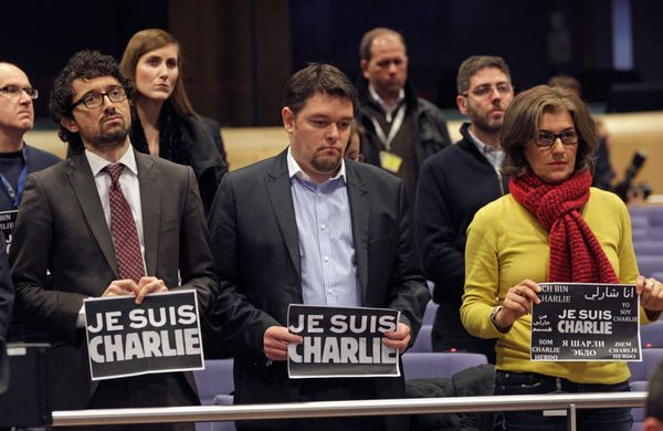 "Journalists show signs that read: ""Je suis Charlie (I Am Charlie)"", as they hold a minute of silence to pay respect for the v"