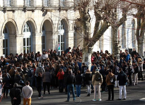 High school students of Paul Bert school gather to observe a minute of silence to pay their respects to the victims of the de