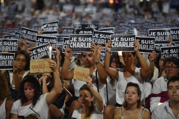 Members of Sydney's French community gather in the heart of the city to hold aloft banners reading 'Je Suis Charlie' (I am Ch