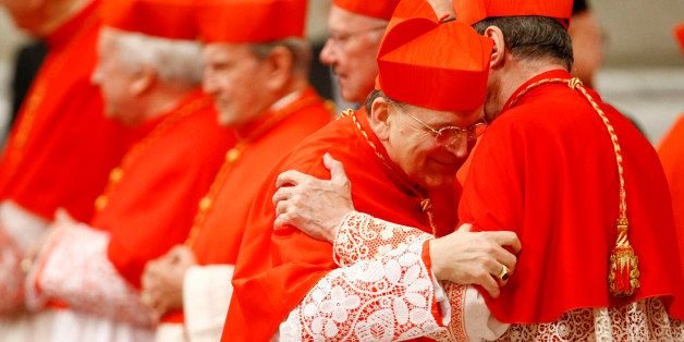 Newly-appointed US Cardinal Raymond Leo Burke, left, hugs Cardinal Giovanni Lajolo during a consistory inside St. Peter's Bas