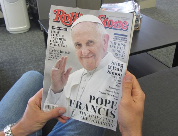 A copy of Rolling Stone magazine is read on January 29, 2014 in Los Angeles, California. Pope Francis is taking his place alo
