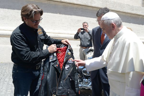 In this June 12, 2013 file photo provided by the Vatican paper L'Osservatore Romano, Pope Francis receives a leather jacket f