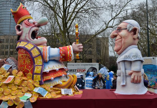 A carnival float depicting a poor pope Francis  right, and a rich cardinal  prior  to the traditional carnival parade in Dues