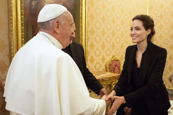 Pope Francis greets Angelina Jolie, at the Vatican, Thursday, Jan. 8, 2015. The actress, director and U.N. special envoy met