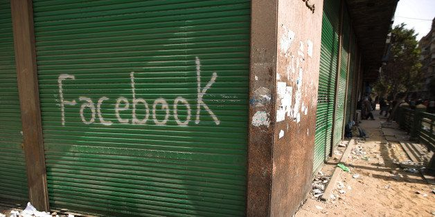 CAIRO, EGYPT - FEBRUARY 04:  A shop in Tahrir Square is spray painted with the word Facebook after the government shut off in